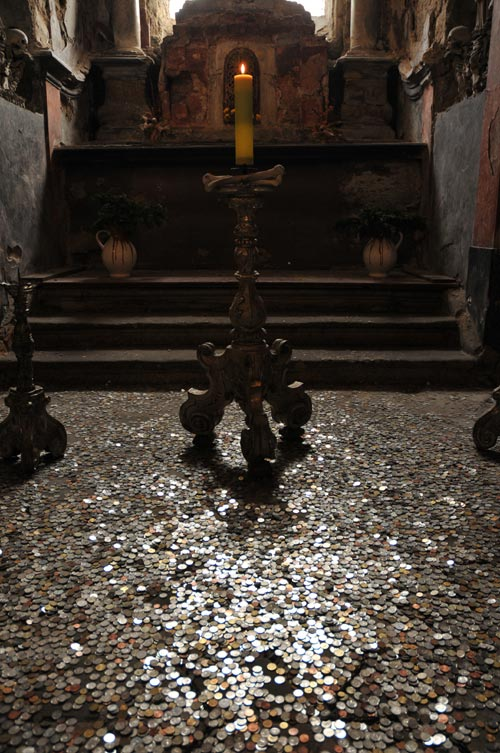 candle and money on floor